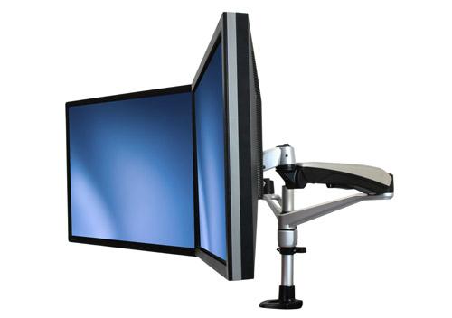 Cree un espacio de trabajo más confortable y productivo mediante el uso de dos monitores, posicionados uno al lado del otro.