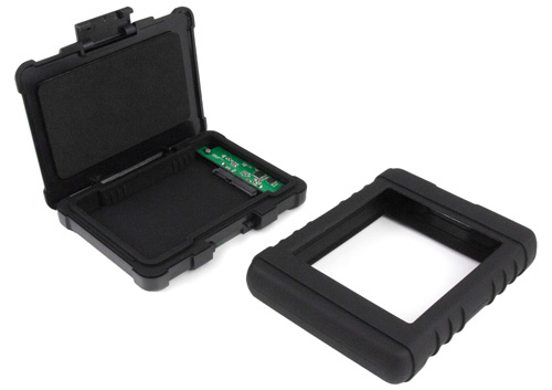 Photo of rugged enclosure shown open with protective silicone sleeve beside
