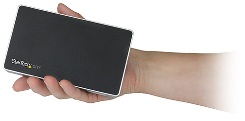The DVI docking station is about the size of one's hand, the image highlights the dock's compact and palm-sized design