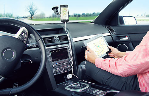 Charging a Samsung phone in a car phone mount while charging the passenger's iPad