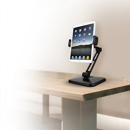 A tablet mounted on the tablet desk stand