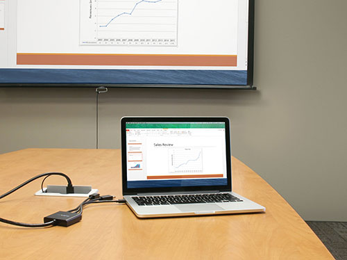 Delivering a presentation using the adapter to connect from a laptop to an HDMI projector