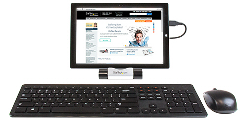 Tablet shown connected to the hub as a host, along with a USB keyboard and mouse attached to the hub