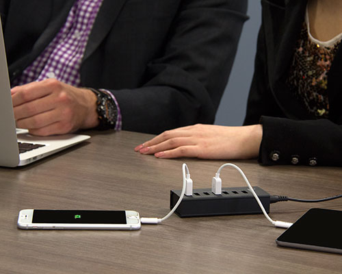 Charging station deployed in a boardroom while charging iPhone and iPad