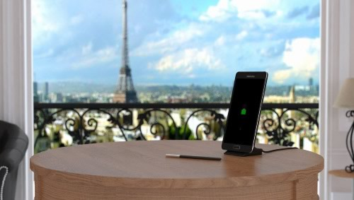 Charging a Samsung Galaxy Note 4 in a hotel room, with the Eiffel tower in the background