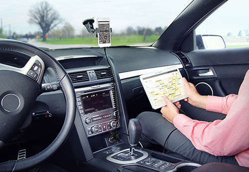 Charging an iPhone in a car phone mount while charging the passenger's Samsung tablet